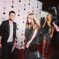 Paris Hilton, Nicky Hilton and Alain Alava on the red carpet in Los Angeles