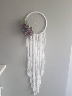 Purple and grey feathered dreamcatcher. This beautiful wall hanging is made with White string and feathers, purple florals attached for that bohemian touch and intricate webbed detail, ready to give you that perfect dreamy night sleep. Size 7inch All dreamcatchers look beautiful in