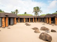 The Best New Spas in the World : Condé Nast Traveler ::: CHILE -   MANAVAI SPA, HANGAROA ECO VILLAGE & SPA, Easter Island  ::: A rock garden enclosed by a volcanic wall—plus four round, ancient-style treatment rooms, an exterior shallow pool, and two hot tubs. Gilligan's Island gone luxe—think black volcanic stone walls, carved driftwood, and cypress pillars over white sand paths.