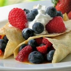 Great idea for a Saturday, summer breakfast. For the filling, mix some fresh berries with yogurt, top the crepe with a dollop of cool whip.