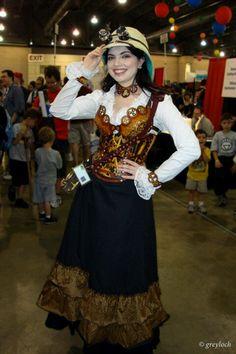 Gorgeous babe in a cosplay safari steampunk dress