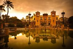 Mudejar Pavilion and pond at sunset. Placed in the Plaza de America, ho , Places In Spain, Places In Europe, Places To Visit, Most Romantic Places, Beautiful Places, Cosmo Travel, Sevilla Spain, Spain And Portugal, Travel And Tourism