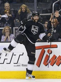 Justin Williams celebrates after scoring a goal against the San Jose Sharks during the second period in Game 7