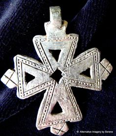 Old Ethiopian Coptic Cross imported from Addis Ababa, Ethiopia. I've had a selection of these crosses stashed away for MANY years now.  This cross is a silver alloy (coin silver) and may very well date back to the turn of the 20th century.These crosses were hand cast and no two are the same. There are strong details that resemble Celtic-like interlaced designs though the Ethiopian coptic cross designs are some of the earliest Christian crosses found.    by TemplesTreasureTrove, $44.95