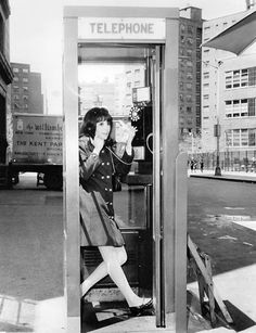 Marlo Thomas 1966.  Nowadays, it is a rare thing to see a telephone booth, anywhere, and even rarer still to find one reasonably intact, with a working phone, a phone book, and a phonebook stand.  Oh, and the door left on the booth!