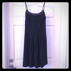 LOFT Black Cotton Eyelet Dress Never been worn, timeless dress! Black cotton with eyelet details at the top. Tie waist at the back allows for very flattering shape! LOFT Dresses Mini