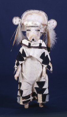 Kachina doll, divinity figure made of wood, cotton, feathers.