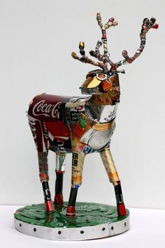 """Elk sculpture made from aluminium cans, by Michelle Reader. Dimensions: 30 x 20 x 20 cm. VOCABULARY, Recycling: """"made FROM"""" (vs. """"made of"""")"""