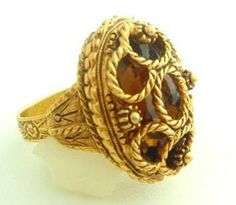 "Fabulous Florenza! This ring is called a wrapped ring. Large amber stone encased in 24k gold plate rope design - made to look like it has several stones. 1 1/4"" X 1"" x 3/8"" high. NEW OLD STOCK. Never worn. Fancy adjustable band. $68 free US shipping. Questions? PM me via FB. PayPal Only."