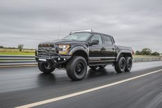 Hennessey VelociRaptor First Look - At SEMA the specialty manufacturer Hennessey debuted the 2018 Ford Raptor You know, when four wheel just a. Ford Velociraptor, Ford Pickup Trucks, Lifted Trucks, Big Trucks, Ford F-150 Raptor, 4 Door Trucks, Hennessey Venom Gt, 6x6 Truck, Power Cars