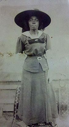 Photo postcard of African American woman in hat