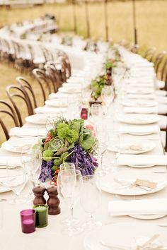 long + rustic reception table // photo by Louisa Bailey // florals by The Flower Jar // styling by The Style Co. // View more: http://ruffledblog.com/melbourne-rustic-wedding/