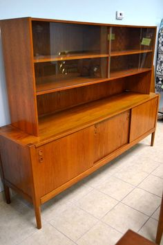 "Mid-Century Modern Solid Teak Sideboard / Hutch (2 Pieces) - Sliding Glass Upper with 2 Adjustable Shelves, Three Lower Sliding Doors (middle section has 3 drawer lined fitted interior) - 2  Adjustable Shelves on Either Side - 78.75"" W x 19.25"" D x 60"" H"