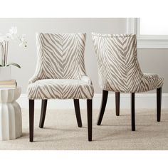Safavieh Lester Grey Zebra Dining Chairs (Set of 2) | Overstock™ Shopping - Great Deals on Safavieh Dining Chairs These would add some fun to your dining room. The dark legs would pull the color from the metal coffee table through, and a subtle animal print like this has become a neutral in the design world. Just a thought. I like to push the envelopes bit. :-)
