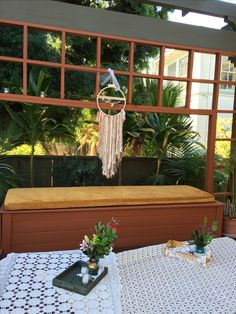 Custom Dream Catchers for the Grad. Backyard party?  Creative seating with custom gold velvet cushions around the crochet covered spa. Add vintage vignettes to honor the grads journey.