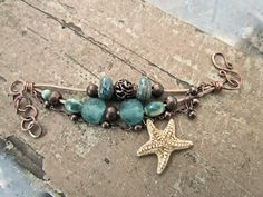 ♥ 10% of animal or sea creature amulet designs donated to animal rescue and rehab ♥  One of a kind handcrafted hammered copper starfish bracelet.