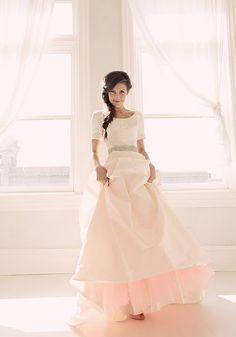 Blush wedding dress with darker pink tulle underneath