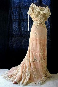 Early 1900's evening dress featuring Tambour lace & embroidered eucre netting over apricot dress.