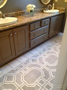 long area rug in bathroom instead of small bath mats