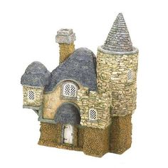 """Primrose Cottage by Cottages and Doors. $325.00. size: 21.5"""" Long x 13.25"""" Wide x 27.25"""" High. scale: 1:12. material: Resin & Granite. This charming fifteenth-century limestone cottage was first constructed in 1405 for fairy Gwenhwyfar. With a thatched roof, heavy stonewalls and a spellbinding slate roofed turret, the two-story timber framed Cotswold Cottage is perfect for insulating against weather of most any extreme. A secret compartment in the back of the co..."""