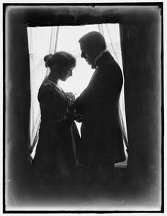 John Murray Anderson and his wife Genevieve Lyon posed at  a window,1915.  She would die a year later from TB.