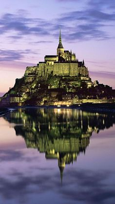 Mont Saint-Michel, Normandy, France  This place holds a special place in my heart. I still remember the guy beating the omelets. What an amazing town, all the shops on the road that winds back and forth climbing to the top.