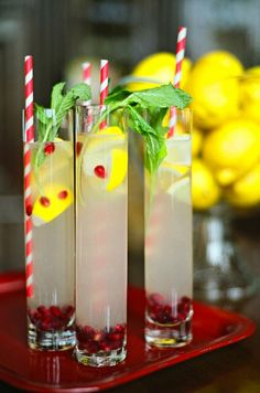 Love this idea for a super cute drink for your Christmas Eve celebration.  Plus, it could not be any easier, which is always a bonus!  Add lemonade to a tall glass and garnish with fresh mint, lemons and pomegranate seeds.  Drop in a fun red and white straw and you are all set.