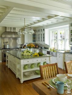 pretty white kitchen with a hint of color in the accessories
