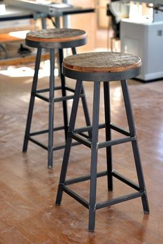 Reclaimed Barnboard wood and steel bar stools. to mix modern-minimalist and rustic