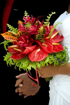 The vibrant colours of the tropics are breathtaking as seen in this island flower Bouquet by Barbados Weddings... beyond your imagination!!   'Pin it' if you like the flowers of the islands. http://barbadosweddings.com