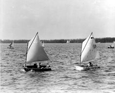 Pram class sailboat racing from Labor Day boat races.  Used to race these, on these waters, when I was 10. Then had a traumatic experience in my life and stopped sailing. Miss it.
