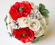 This peony, succulent, rose and pinecone bridal bouquet was made using pages from the bride's favorite book!