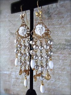 FUF 5/8/15 and May Challenge, chandeliers on RGP brass B'Sue filigrees, ceramic roses and old vintage rosary chain, oval glass vintage rosary chain bits in white and brass charms.