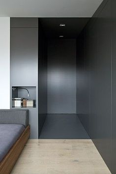 Lovely dark hallway millwork creating a dramatic high contrast transition to the rooms beyond