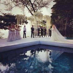 That looks gorgeous, but let me tell ya. I'd be SO scared of falling in that water on the way down the aisle.