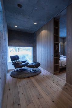 Charles Eames Lounge Chair in L House Corridor with Sliding Book Case Wall to Bedroom