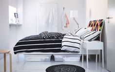 A black and white bedroom with a white TUVBRÄCKA bed and DUKEN bed linen in black and white (I like the clean, white furniture.)
