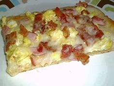 Breakfast Pizza  1 roll crescent rolls 1 pkg. white (country) gravy mix (1 Cup) 4 eggs, scrambled 5 slices cooked bacon, crumbled 5 slices canadian bacon, diced 1 C. mozzarella cheese  Roll out crescent roll dough onto a greased cookie sheet and flatten out. Place in a preheated 350 degree oven for 7 minutes. Remove from oven and set aside. Prepare packaged gravy mix according to directions. Spoon gravy over dough and spread around to cover completely. Top with eggs, both bacons, and ...