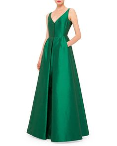 Akris shantung gown. V neckline; hidden front zip. Sleeveless; moderate shoulder coverage. Side slip pockets. Fitted bodice; full skirt. Inverted center pleat. Straight hem. Silk. Imported.