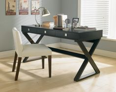 This narrow desk is a stylish addition to any compact home office space. Features three functional drawers and a dramatic x-base. Constructed of solid maple and maple veneer.