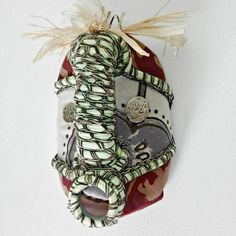 Shop our collection of beautiful textile African masks, handmade from upcycled containers and embellished with an assortment of local fabrics and other media by local artisans in Hout Bay, South Africa. Blue Orange, Red And Blue, Patchwork Fabric, African Masks, African Fabric, Printing On Fabric, Hand Sewing, Upcycle, Artisan