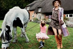 """In Full Swing - """"You can't make plans in this business at all,"""" says Miller, pictured with her two-year-old daughter, Marlowe. Derek Lam suede patchwork coat and belt. Saint Laurent by Hedi Slimane printed silk dress. Albertus Swanepoel fedora. Emilio Pucci suede boots. Fashion Editor: Tonne Goodman."""