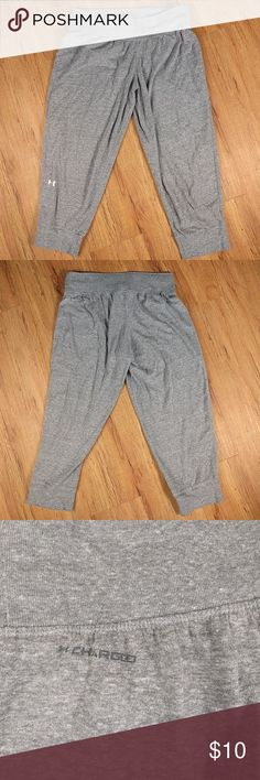 "Under Armour Gray Cropped Workout Pants Under Armour Gray Cropped Workout Pants  Size Small, in GUC.  Flat waist measurement 14""  Inseam 20"" Under Armour Pants Track Pants & Joggers"