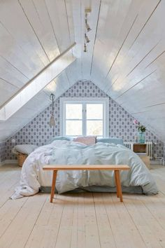Quaint, Open Attic Bedroom Design with Patterned Wallpaper