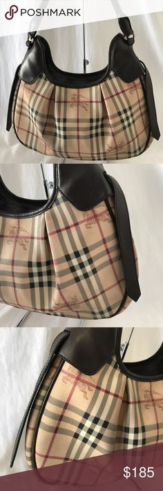 Burberry shoulder bag Authentic bag with serial number inside,has some used with ink stain inside and exterior,I tried to removed it my household stuffs but I can't seemed to find a good chemical to used,the bag look gorgeous despite of all the flaws. Burberry Bags Shoulder Bags