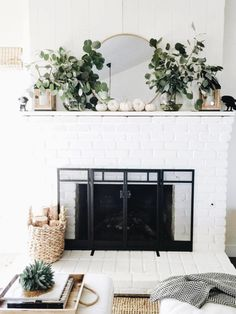 Pretty fall mantle with white pumpkins and eucalyptus
