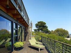 Coastal Hillside Home by Pfau Long Architecture