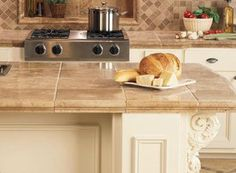 Check Out These 11 Amazing Tile Counters: Large Beige Tiles on a Kitchen Island