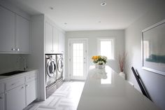 modern laundry room with stainless steel appliances