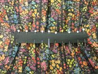 nipped-in the back by easing some of the excess fullness onto a strip of elastic.
